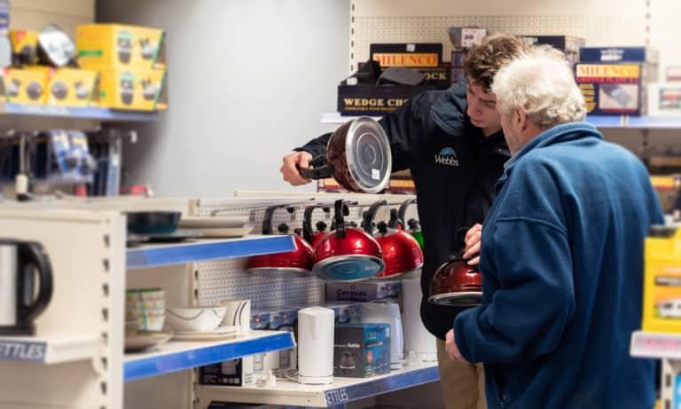 Staff assisting customer in the Webbs Caravans accessories shop in Salisbury.