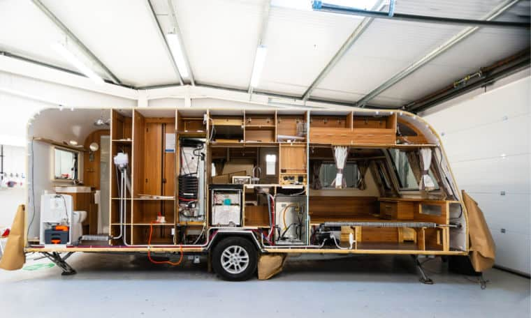 Side-view of a caravan's interior during a habitation service at Webbs caravan service centre.