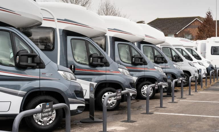 An array of Motorhomes lined up in the Webbs Motor Caravans' forecourt in Reading.
