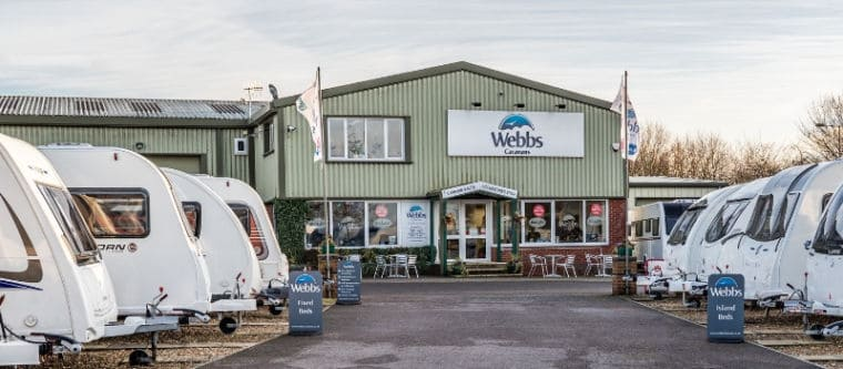 Webbs Caravans branch in Salisbury from the forecourt with some used-caravan stock.