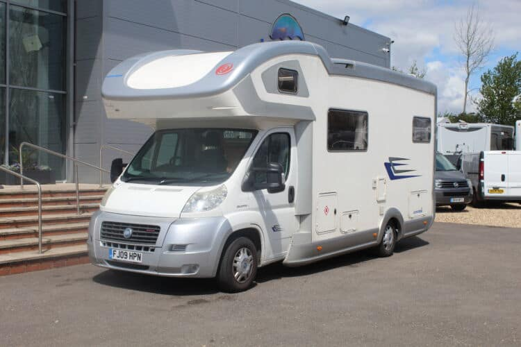 Front-view of an Euramobil Terrestra 690 HB motorhome for sale at Webbs Motor Caravans's forecourt.